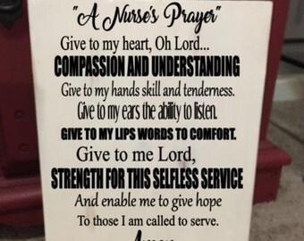 A nurse's prayer wooden sign