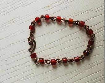 Copper bracelet with red glass beads