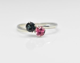 Sterling silver ring with two tourmaline gemstones.