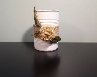 White upcycled tin can with burlap and flower