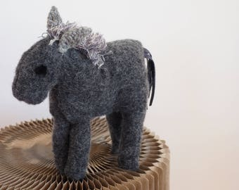 Large gray donkey in wool