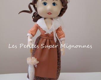 Fofucha Provencal doll holding an umbrella