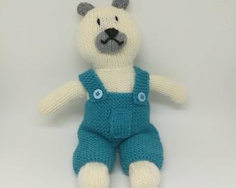 White bear in blue overalls