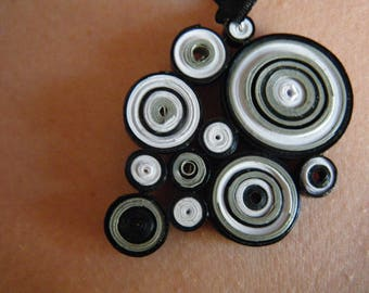 Grey, white and black color quilling pendant with black satin ribbon