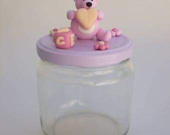Jar for storing small items of baby