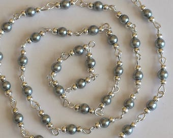 55cm of string/grey glass Pearl 4mm beads