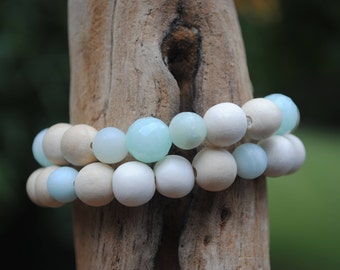 Amazonite, wood, and faceted dyed jade. One left; top bracelet.