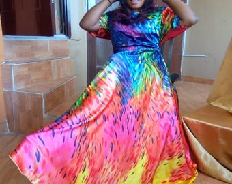 Multi color Lima flare maxi dress with side pockets and elastic waist.