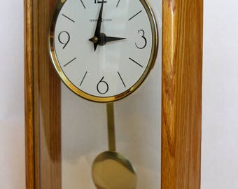 howard miller modern mantel clock with a solid oak frame
