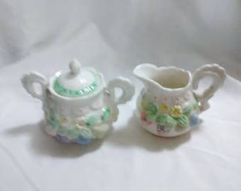 Vintage fruit creamer and sugar set. Pastel colored fruit on white ceramic.