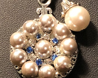 Recycled pearls on disc necklace with crystal accents.  Silver snake chain with pearl dangle.  lobster claw clasp.