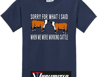 "Sorry for what I said, when we were working cattle black shortsleeve men or womens T shirt .With two cows talking""Sorry for what I said"""