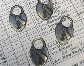 Antique Lock Charms set of 4 antiqued brass