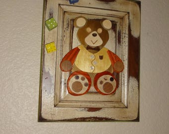 Mr. Teddy Bear Hanging Out On A Cabinet Door.