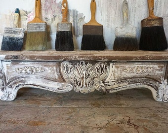 Rustic ornate wooden shelf wall hanging French farmhouse style shelving rose garland embellished painted wood home decor anita spero design