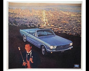 1965 Blue Mustang Convertible over San Francisco CA.  Classic V-8.  Bernard was a Born Loser.  City Scape.  Vintage Mustang.  Ready Frame.