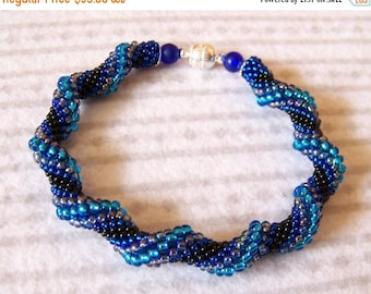 15% SALE Spiral bracelet in blue and black - Beadwork bracelet - Cellini Spiral Beadwoven Bangle Bracelet - Twisted - Modern bracelet