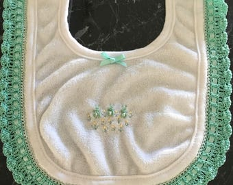 Embroidered baby bib with crocheted edge