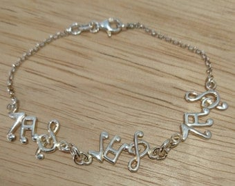 Vintage sterling silver music note bracelet