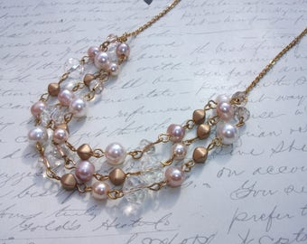 Pearls and crystals gold multi strand necklace