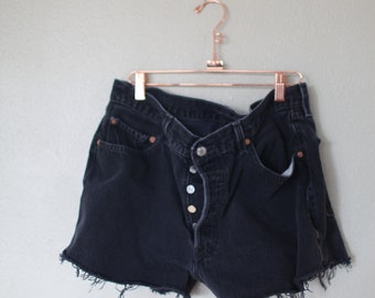 vintage 1980's distressed black cut off levis 501 button fly  jean shorts 34