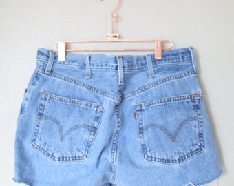 vintage 1980's distressed cut off levis 501 button fly  jean shorts 36 38