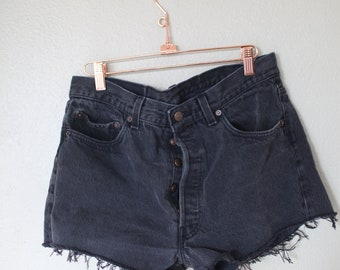 vintage 1980's distressed black cut off levis 501 button fly  jean shorts 32