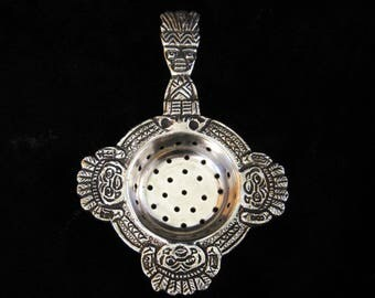 Unusual Silver Plated Tea Strainer, Decorated with Primitive Masks