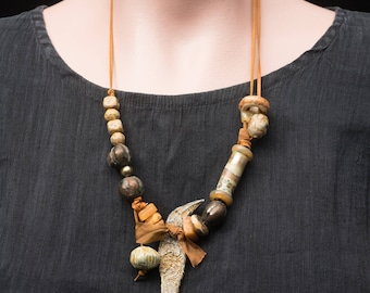 Crow Medicine, raw ceramic bird amulet, a rustic assemblage necklace with artist beads, shades of amber, glass and clay, handmade, unique