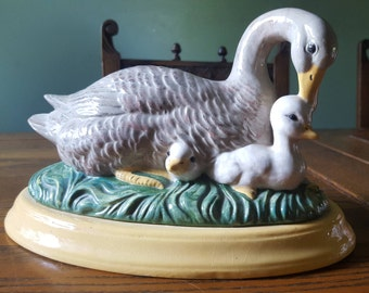 Mother duck and ducklings, ceramic statue