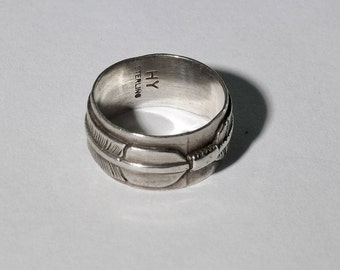 Native feather ring signed HY Sterling