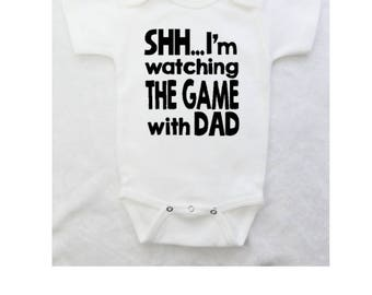 "Funny Baby Bodysuit ""Shh...Im watching the game with dad"" for Boy or Girl - White Bodysuit"