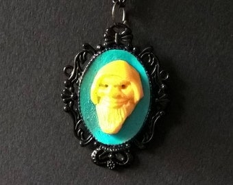 "Necklace "" STRANGE LEPRECHAUN "" Yellow and Turquoise Blue mounted on black cameo"