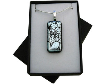 Handmade fused glass green 'HEARTS' pendant.