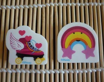 "Erasers character ""SOY LUNA"" a skating shoe and a rainbow smiley, sold in packs of 2."
