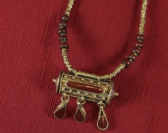 Vintage Kuchi necklace with openable brown prayer box