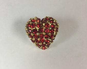 Red crystal heart brooch.