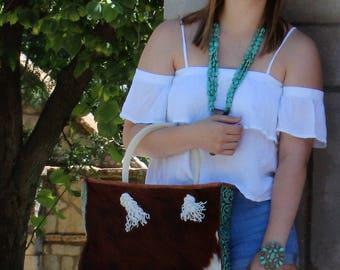 Cowhide and Turquoise Embossed leather Tote
