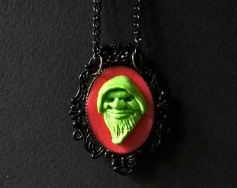 "Necklace "" STRANGE LEPRECHAUN "" Green Apple and Red mounted on black cameo"