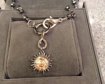 Swarovski sun burst pendant with