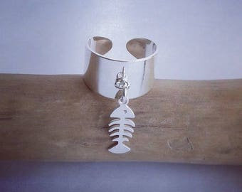 "Adjustable silver ring 925 (stamped) and ""Fishbone"" charm also in 925 sterling silver."