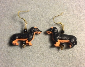 Black and brown ceramic dachshund bead dangle earrings adorned with black Czech glass beads.