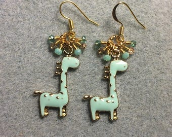 Light turquoise spotted enamel giraffe charm earrings adorned with tiny dangling turquoise and gold Chinese crystal beads.