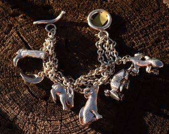 Sterling silver southwest cowboy charm bracelet, Susan Cummings vintage coyote, boot, hat. armadillo,lizard, bunny huge.