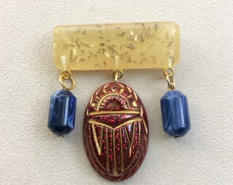 Mystic Nile - Gold Confetti Lucite Style Deco Egyptian Revival Scarab / Beetle Brooch in Ruby Red Sparkle and Labis Blue Beads. Gatsby
