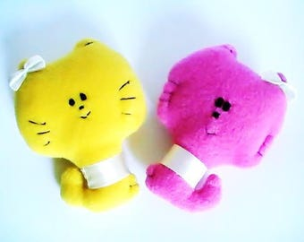 Pink and yellow cat plush toy