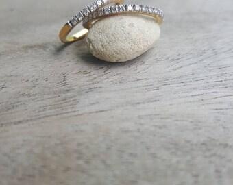 90% gold with 0.015 karat half round diamond.