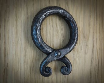 Big Troll cross on the wall.Hand forged blacksmith amulet.