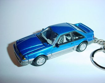 3D 1990 Ford Mustang GT custom keychain by Brian Thornton keyring key chain finished in blue/silver color trim hood opens diecast metal body