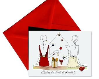 Carte de Noël pliée, enveloppe rouge.